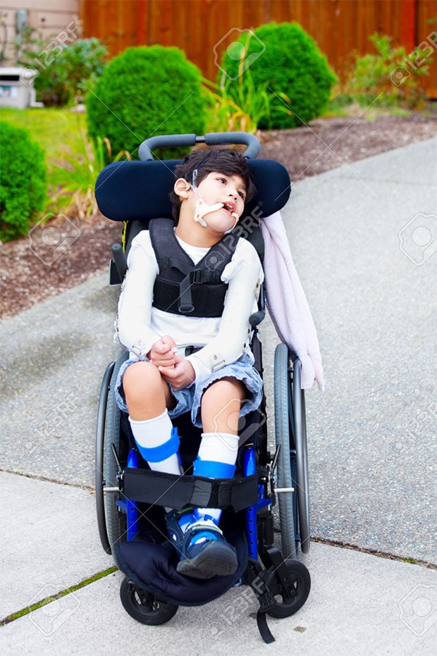 23378763-Seven-year-old-biracial-disabled-boy-in-wheelchair-Child-has-cerebral-palsy--Stock-Photo-Global-Media
