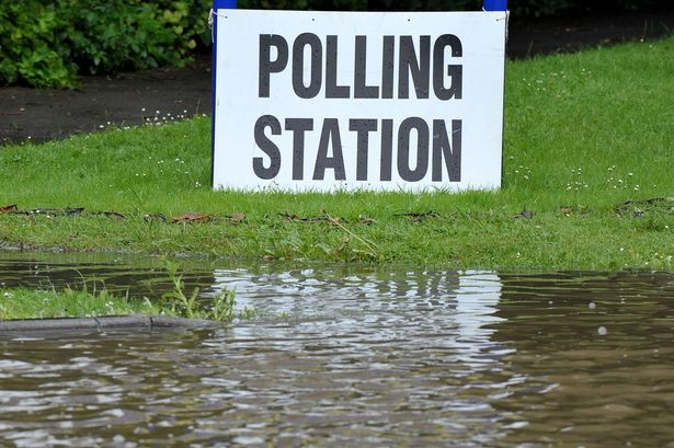 DEC23-A-polling-station-sign-sits-nest-to-a-flooded-path-at-a-polling-station-in-East-Hanningfield