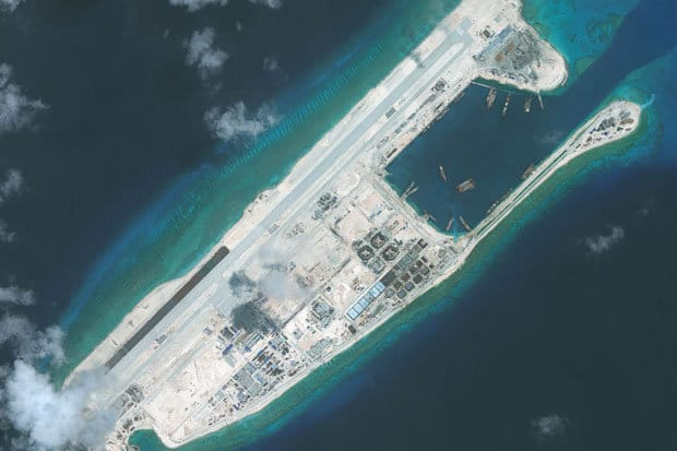 COLONISING MENACING A Chinese naval base constructed on the Fiery Cross Reef