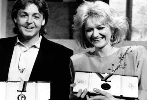 Vesna gets her Guinness Book of Records award from Paul McCartney in 1985